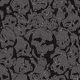 Jeans skulls. Abstract seamless pattern from skulls and textured jeans denim linen fabric background. Vector Illustration Stock Photos
