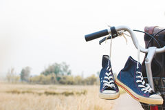 Jeans sneakers and bag on  bicycle Stock Photography