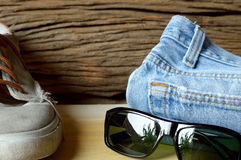 Jeans sneakers and sunglasses Stock Photo