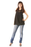 jeans som ler kvinnabarn royaltyfri foto