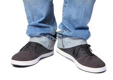 Jeans & sport shoes Stock Images