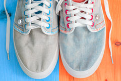 Jeans sports shoes Stock Photos