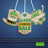 Jeans St. Patrick`s Day 3 Carton Price Stickers Hat Shamrock. 3 price stickers on the jeans background for St. Patrick`s Day Sale Stock Photos
