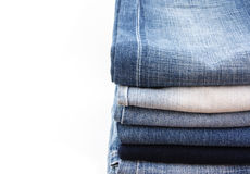 Jeans. Stack of jean on whie background Royalty Free Stock Images