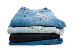 Free Jeans Stack On White Royalty Free Stock Image - 149528486