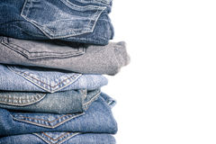 Jeans stack on white background Royalty Free Stock Images
