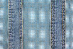 Jeans with stitch on blue dot cloth Royalty Free Stock Photography