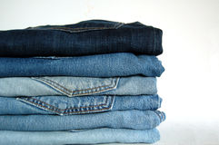 Jeans on stock. Some pairs of jeans on the table Stock Photo