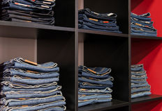 Jeans store: goods on the shelfs Royalty Free Stock Images