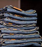 Jeans store: goods on the shelfs Stock Images
