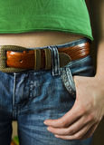 Jeans with a strap. And hand Royalty Free Stock Image