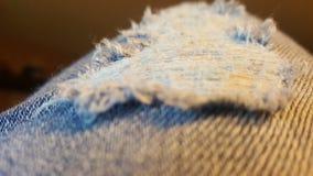 Jeans strappati immagini stock