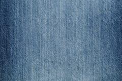 Jeans strutturati blu del denim Fotografie Stock