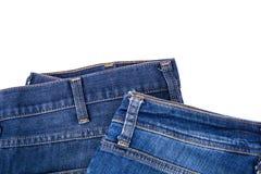Jeans sur le fond blanc Photos stock