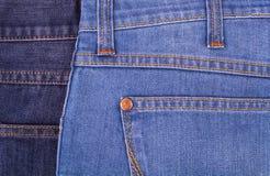 Jeans sur le fond blanc Photographie stock libre de droits