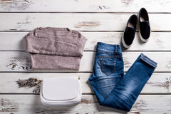 Jeans with sweatshirt and shoes. Royalty Free Stock Photo