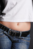 Jeans and T-shirt detail Royalty Free Stock Photography