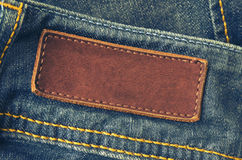 Jeans Tag. Close-up of old leather tag with copy space on blue jeans back Royalty Free Stock Photo