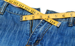 Jeans and tape measure Royalty Free Stock Photography