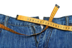 Jeans and tape measure Royalty Free Stock Photos
