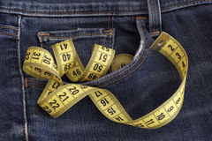 Jeans with tape measure in pocket Royalty Free Stock Images