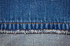 Jeans texture. Worn blue denim jeans texture with stitch and reverse side Stock Photo