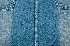 Jeans texture. Worn blue denim jeans texture with stitch Stock Photo