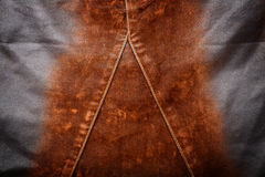 Jeans texture. Worn brown jeans texture with stitch Royalty Free Stock Photo