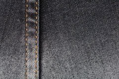 Jeans texture. Worn black jeans texture with stitch Stock Photo