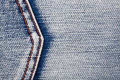 Jeans texture. Heavily worn blue denim jeans texture with stitch Royalty Free Stock Image