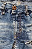 Jeans texture. Aged blue jeans close-up. Texture royalty free stock photos