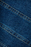 Jeans texture. Worn blue denim jeans texture with stitch Royalty Free Stock Images