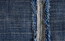 Jeans texture or background denim blue with tear Royalty Free Stock Photo