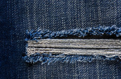 Jeans texture or background denim blue with tear Stock Photo