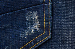 Jeans texture or background denim blue with tear Stock Photos