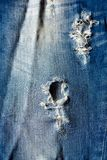 Jeans texture background denim blue with tear. Old jeans texture background denim blue with tear Stock Image
