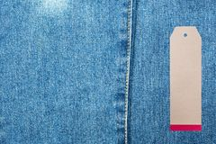 JEANS texture background with tag. Denim jeans background with seam of jeans fashion design and tag Royalty Free Stock Image