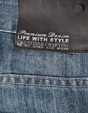 Jeans texture with black label Stock Image