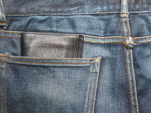 Jeans texture , Blue denim jeans with black lether wallet Stock Photography