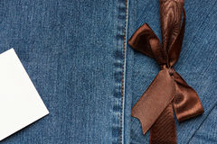 Jeans texture with brown ribbon Royalty Free Stock Photography