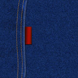 JEANS TEXTURE WITH LABEL. Jeans texture with seam and label Stock Photography