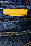 Jeans texture with leather label. Royalty Free Stock Image