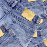 Jeans texture with leather label isolated white background Royalty Free Stock Photo