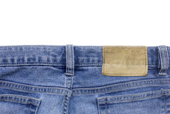 Jeans texture with leather label isolated white background Royalty Free Stock Photos