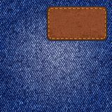 Jeans texture with leather label. Vector Stock Image
