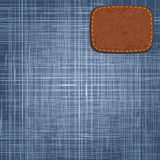 Jeans texture with leather label. Vector Royalty Free Stock Image