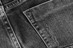 Jeans texture with pocket. Highly detailed closeup of gray denim royalty free stock image