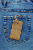 Jeans texture and price tag Royalty Free Stock Image