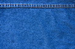 Jeans texture with seam Stock Photos