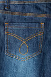 Jeans texture with seam. Closeup image of a denim jeans, back pocket Stock Image